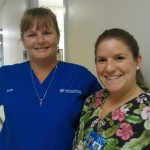 Veterinary cardiology technician Bonnie Heatwole with technology student Ari Flink.