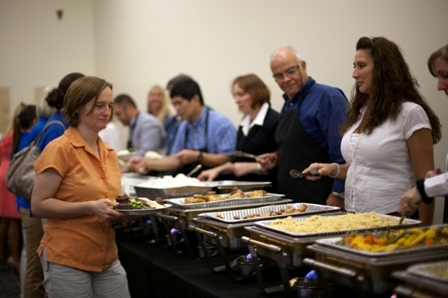 Veterinary faculty and staff assisted in serving dinner to the technicians.