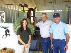 Student Stacey West with Union Rags, Dr. Luis Castro and Michael Matz