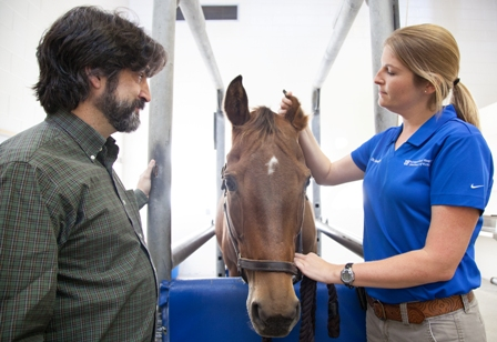 Dr. Sarah Reuss with horse.