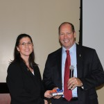 Dr. Julia Conway presents Congressman Ted Yoho (UF CVM '83) with a token of appreciation for his visit to the UF CVM on Jan. 10.