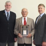 Dr. Art Donovan, left, introduced Dr. Maarten Drost, center, during his induction into the Cattle Production Veterinarian's Hall of Fame, held as part of the Association of Bovine Veterinary Practitioners annual meeting on Sept. 26. At right is Dr. Scott Nordstrom of Merial.