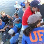 Megan Strobel conducts hearing tests on a dolphin.
