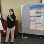 Dr. Amy Stone and Geoff Landau with poster