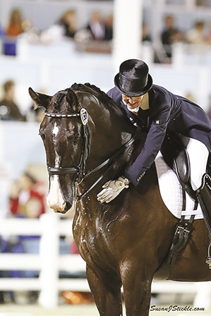 Rider and trainer Kelly Layne strokes Udon P. after he successfully completed a Grand Prix test during Dressage at Devon in September 2014.