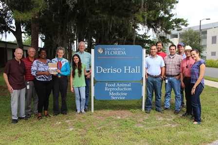 Members of UF's food animal reproduction and medicine service pose with Dr. Temple Grandin at Deriso Hall following a morning tour of UF's dairy and beef units on Sept. 24.