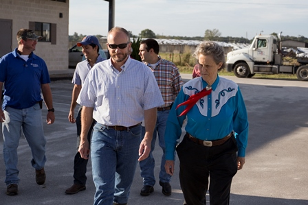 Temple Grandin, right, with Dr. Geoff Dahl of IFAS and others from the UF CVM gather at the UF dairy unit in Hague for a tour on the morning of Sept. 24.airy and beef research units.