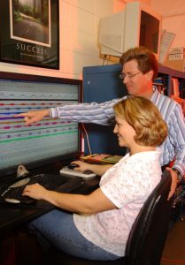 Dr. Don Bolser, shown with scientist Melanie Rose in his laboratory, is one of the few scientists studying how and why we cough. (File photo)