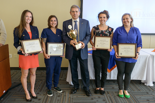 "Student winners in the ""Top Dog"" competition are shown with Dr. Juan Samper, associate dean of students and academic affairs."