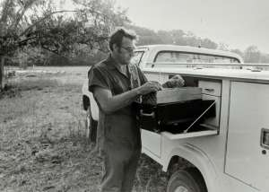 Dr. Braun with his truck in the field.