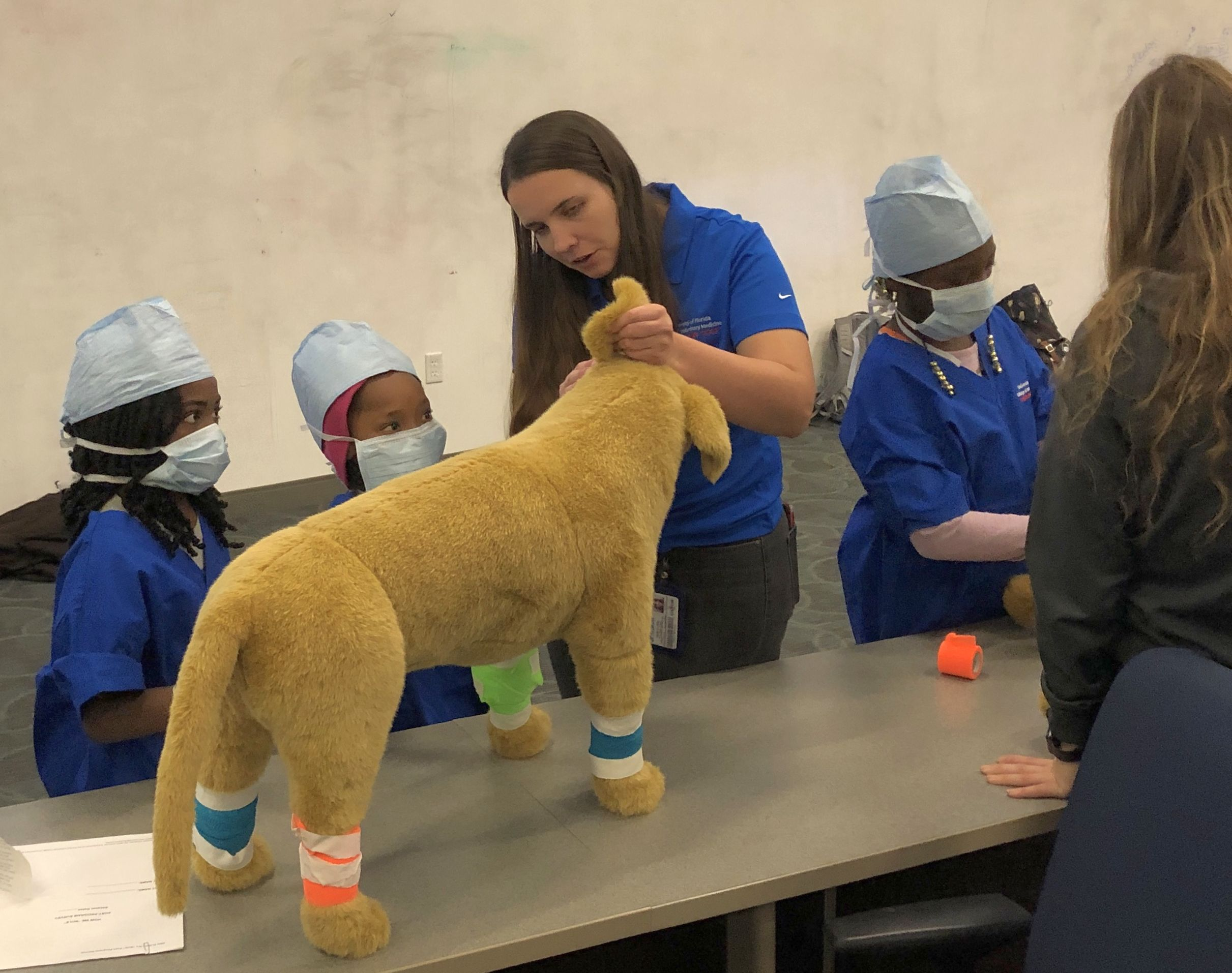 Girls from Girl's Place get hands-on training in clinical techniques through How We Role program