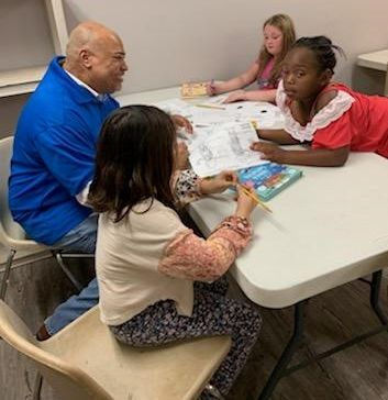Dr. Michael Bowie instructs girls from Girls Place